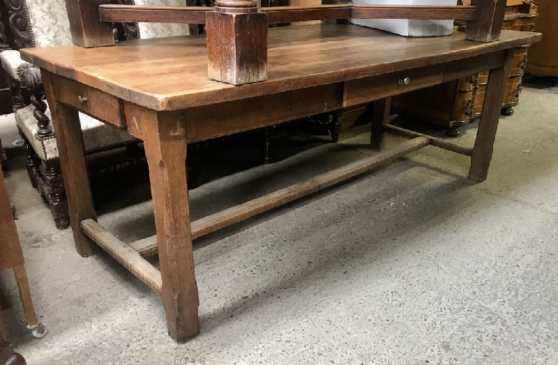 French oak refectory table with stretcher base and central drawer.