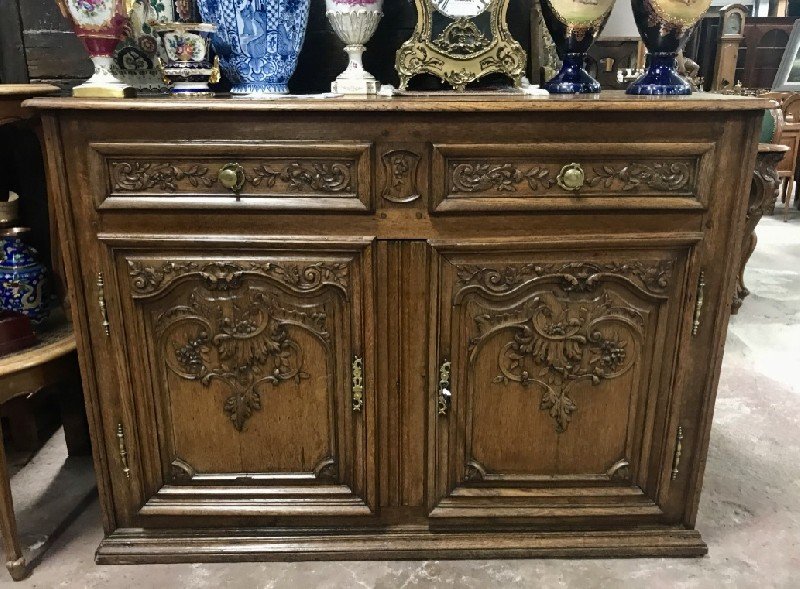18th century French oak buffet, with hand carved floral doors and original bronze handles.