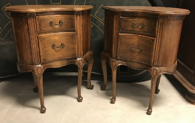 Unusual pair of French provincial walnut corner bedside cabinets.