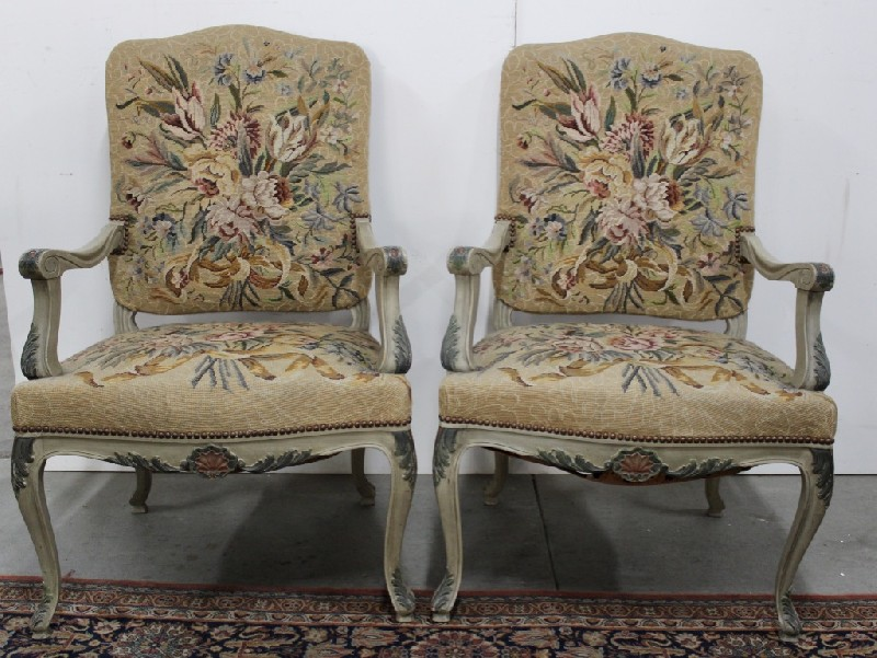 Pair of early 20th century French lacquered & floral decorated fauteuil arm chairs having floral tapestry upholstery.