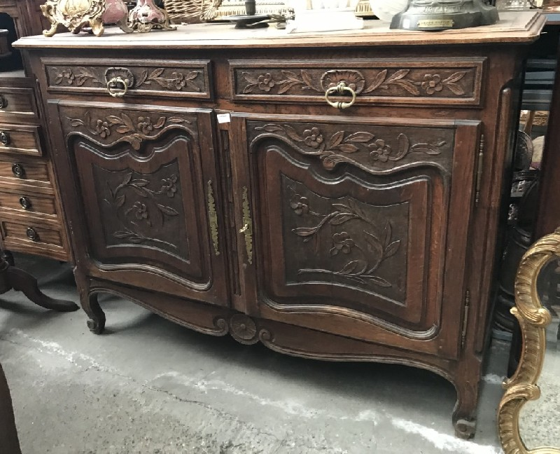 French provincial carved oak two door buffet.