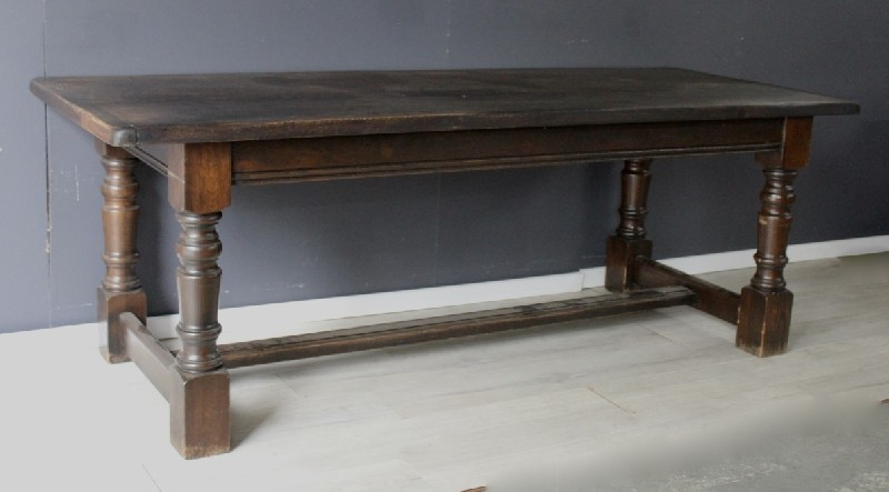 French provincial oak refectory table haveing turned legs and stretcher base