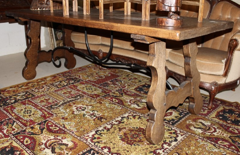 Spanish style oak & iron based pedestal refectory table.