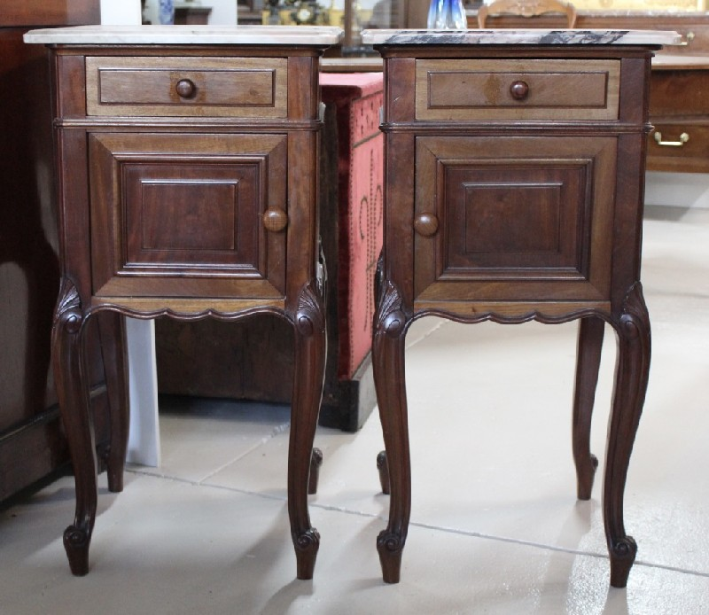 Pair of French 19th century Louis XVth walnut bedside cabinets with purple & white marble tops.
