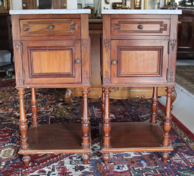 Pair of 19th century French walnut bedside cabinets with white marble tops.