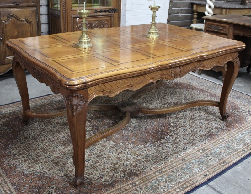 Decorative French Louis XVth fruitwood and inlaid parquetry top draw-leaf dining table with stretcher base and wonderful carvings to the skirt.