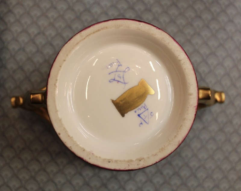Sevres hand painted porcelain and gilt decorated lidded cup and saucer, beautifully incribed to the base.