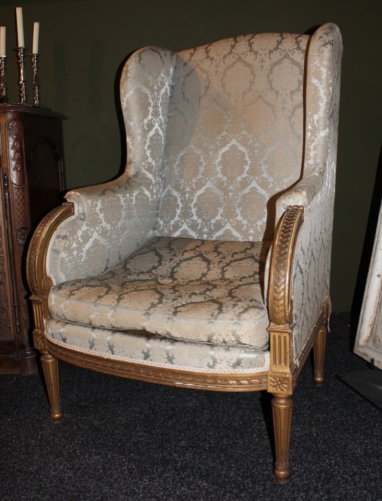 French gilt wood and upholstered bergere arm chair.