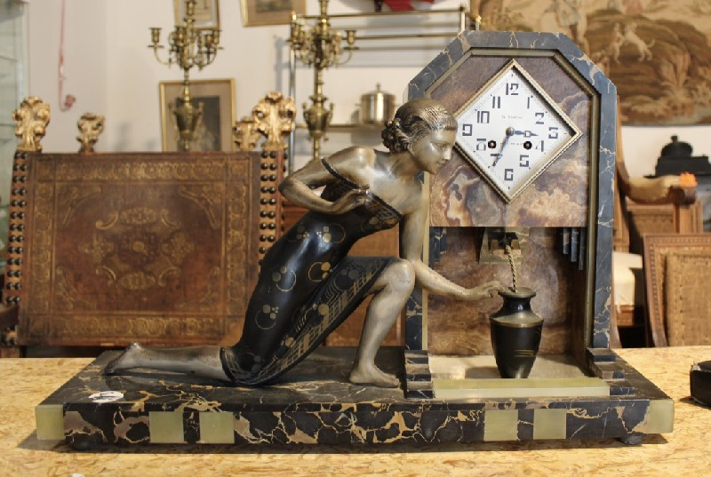 French art deco maiden figured mantle clock on marble base.