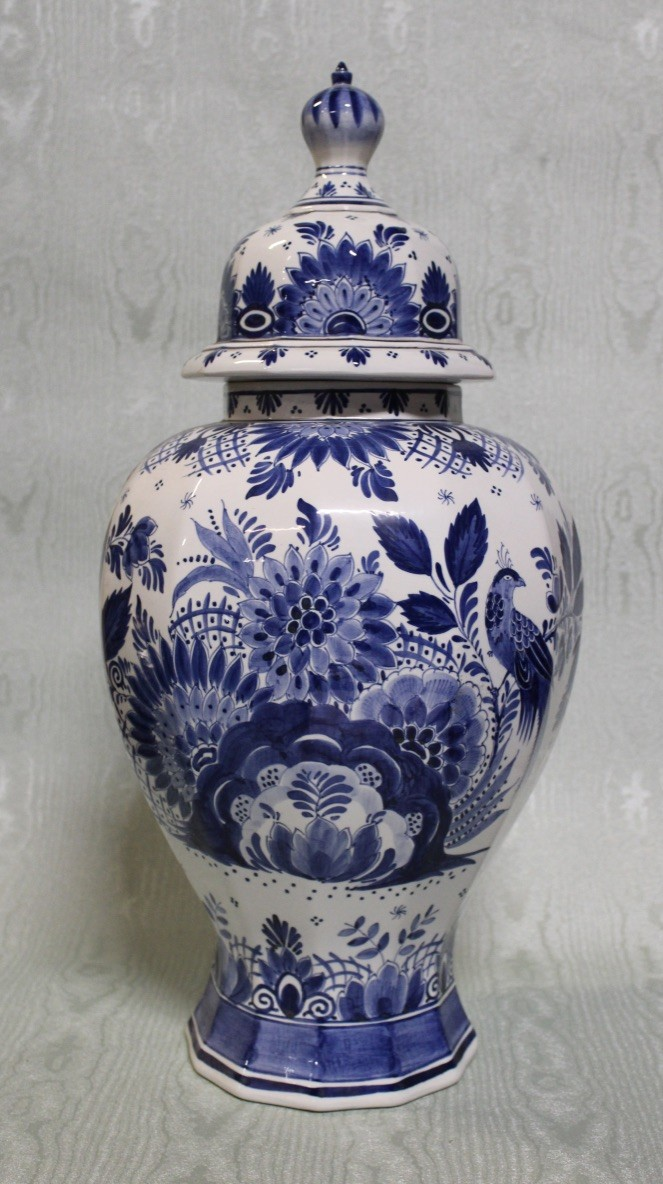 Tall Delft blue and white floral porcealin vase and cover.