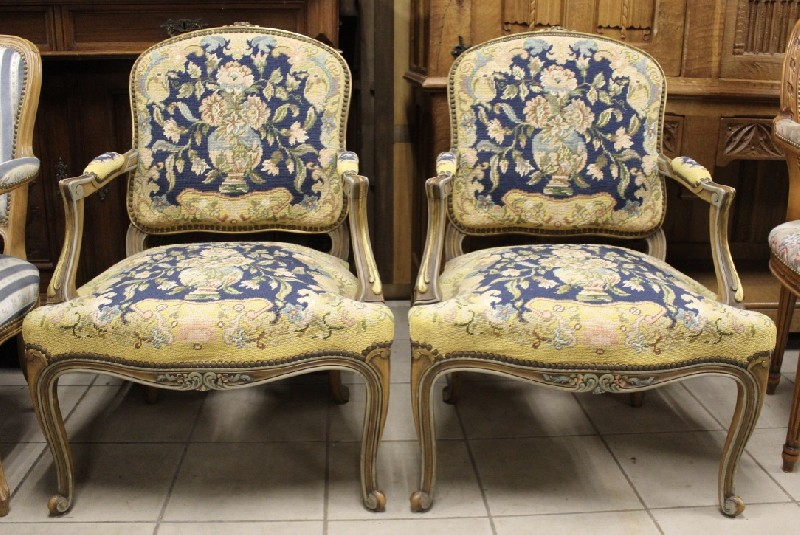 Pair of Louis XVth lacquered and gilt floral carved fauteuils having hand woven tapestry upholstery.