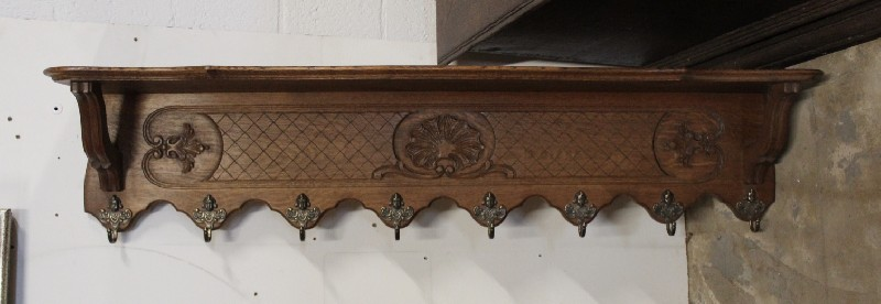 French oak & floral carved coat rack with brass hooks.