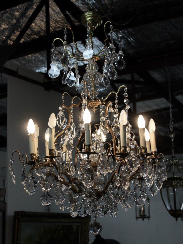 Superb large French early 20th century brass 12 branch chandelier with cut crystal prisms.