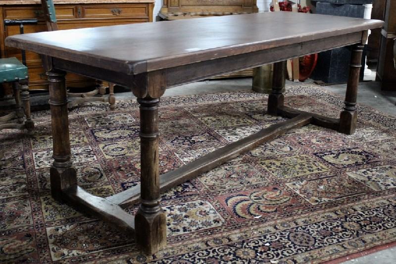 French country oak farm house table having stretcher base.