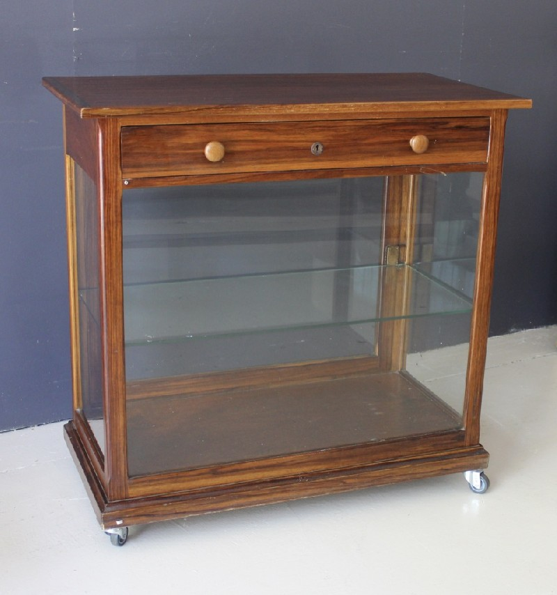 French early 20th century walnut & glass display cabinet with drawer and door.