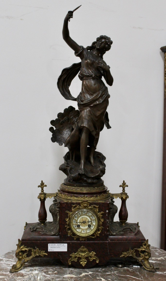 Impressive 19th century French spelter maiden figured mantle clock on rouge marble base, with bronze mounts. Price $1650.