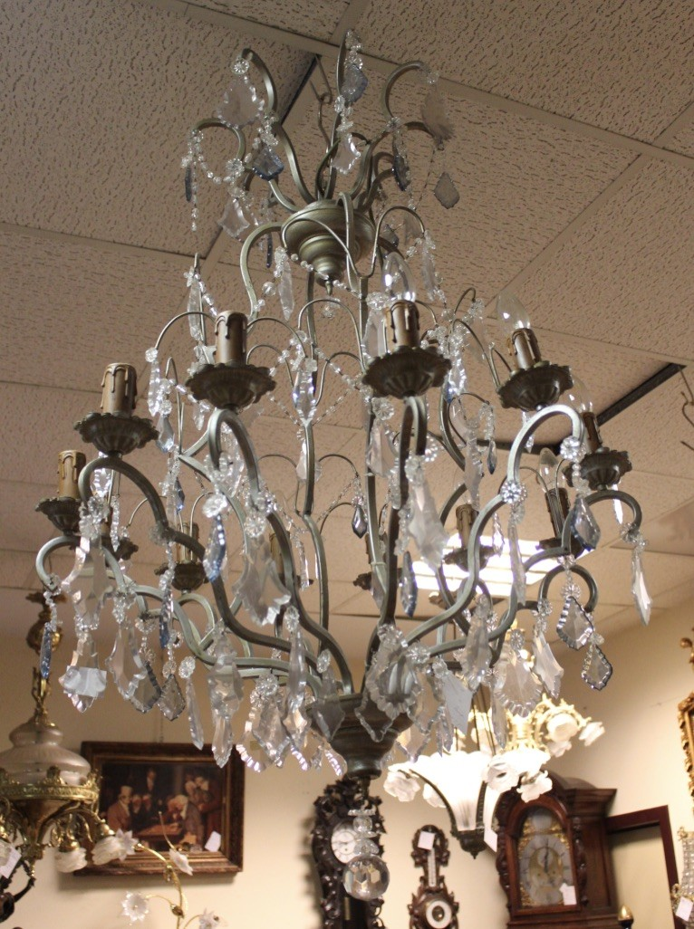 Large French nickle plated & harp shaped chandelier, having clear and blue crystal drops. Price $1650