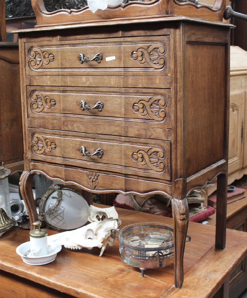 French provincial carved oak 3 drawer chest with bronze handles. Price $550