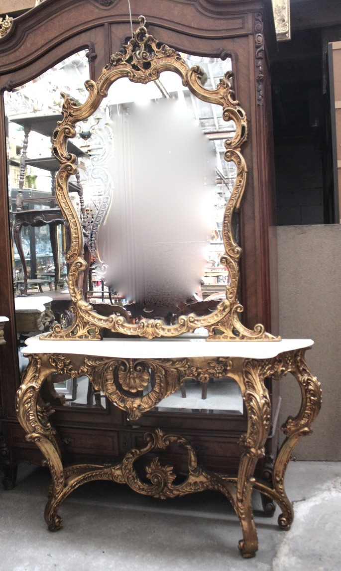 Fine Louis XVth gilt decorated and marble top console table and matching mirror. Price $2600