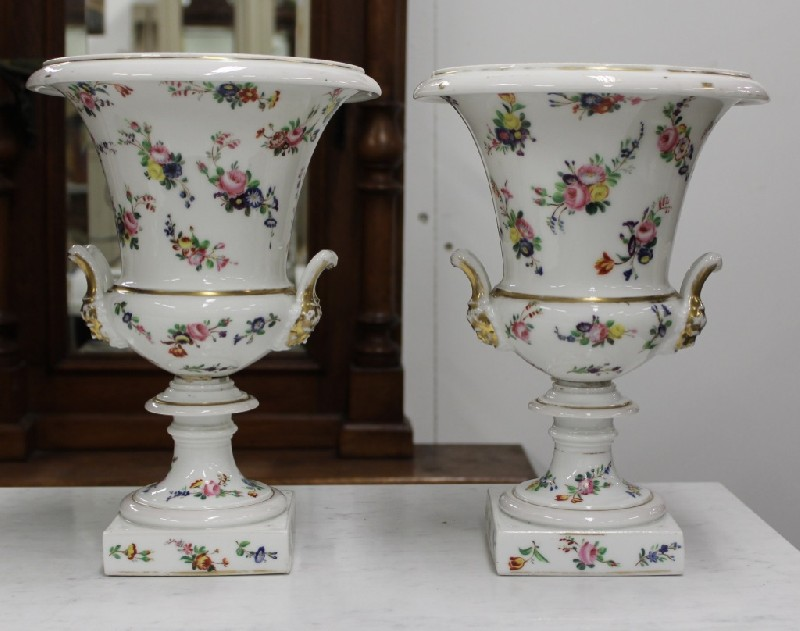 Pair of Paris porcelain and floral decorated 2 handled urn shaped vases. Price $750 pair.