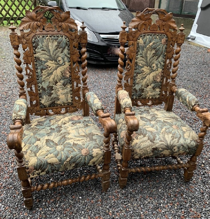 Fine pair of 19th century French floral carved oak and floral upholstered fauteuil arm chairs. Price $1800 pair.